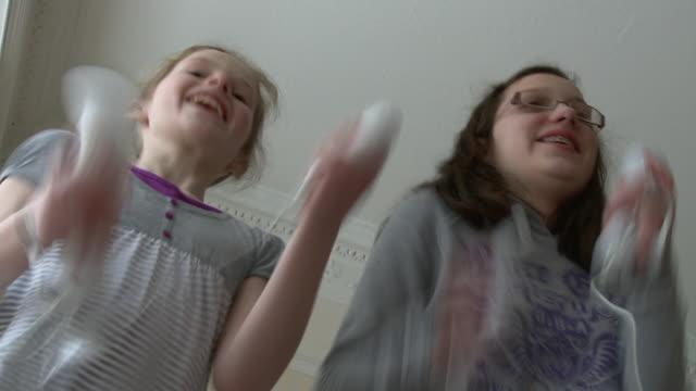 MS Two girls (8-15) playing on Wii / Chislehurst, Kent, UK