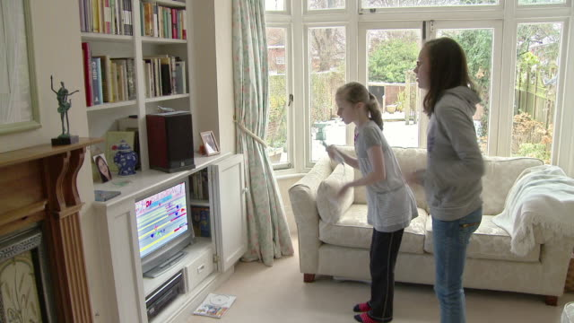 MS Two girls (8-15) playing on Wii / Chislehurst, Kent, UK