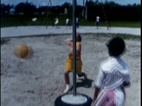 1969 montage two girls playing tetherball on playground / rockport, texas, usa - only girls stock videos and b-roll footage