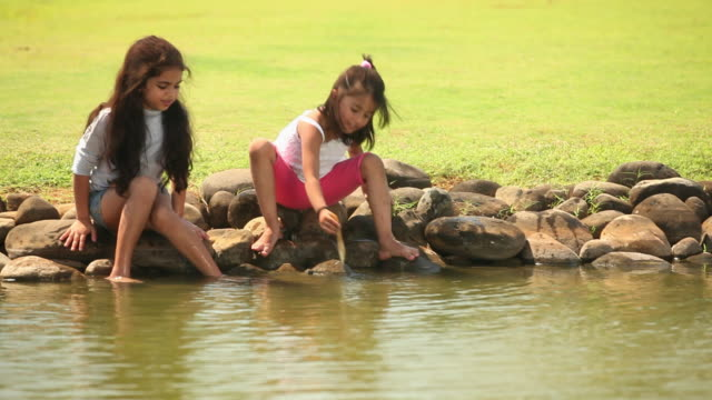 two girls playing with water  - newoutdoors stock videos & royalty-free footage