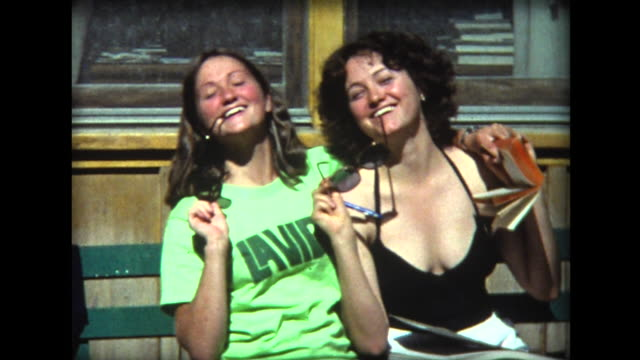 1975 two girls posing with sunglasses - 1975 stock videos and b-roll footage