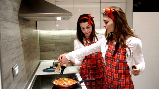 two girls preparing vegan dinner with soy sauce at home - savoury sauce stock videos & royalty-free footage