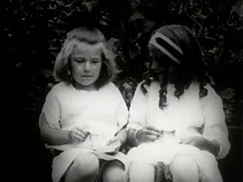 ms, b/w, two girls (4-5) pretending to drink tea when kissing, usa - innocence stock videos & royalty-free footage