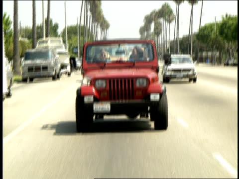 stockvideo's en b-roll-footage met two girls riding in red jeep - passagiersstoel