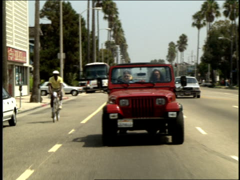 Two Girls Riding in Red Jeep