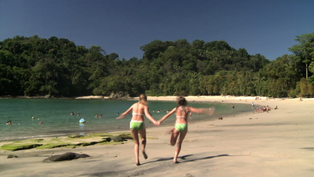 two girls running on the beach - see other clips from this shoot 1157 stock videos & royalty-free footage