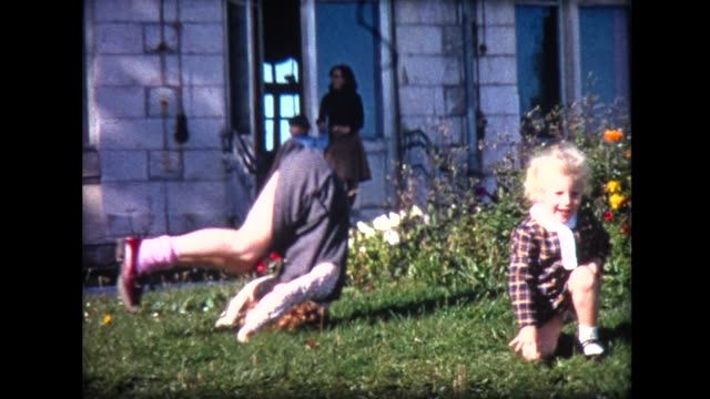 1969 two girls tumble in garden - sister stock videos and b-roll footage