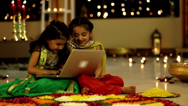 ms pan two girls using laptop during diwali festival - votive candle stock videos and b-roll footage