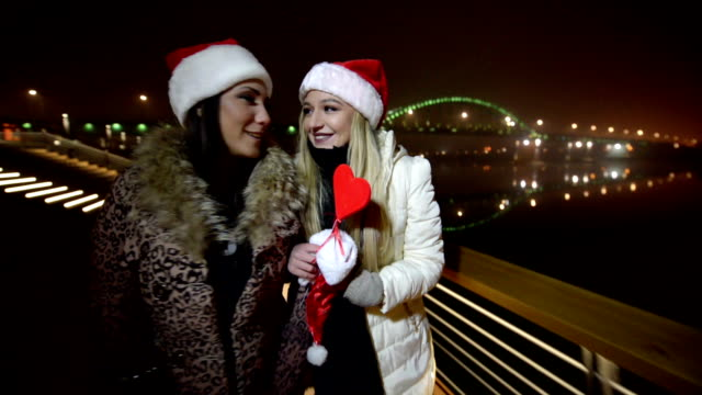 two girls walking with santa hats - comforting colleague stock videos & royalty-free footage