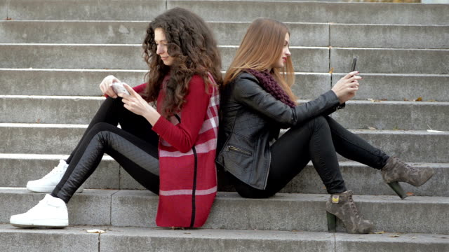 Two girls with smartphones