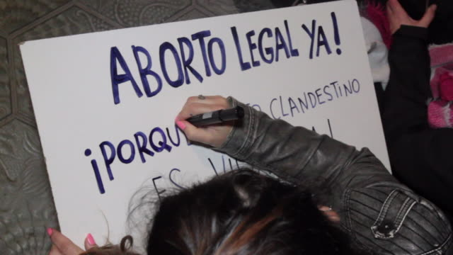 stockvideo's en b-roll-footage met two girls writing placards for the demonstration in barcelona on monday to denounce violence against women on the international day for the... - placard