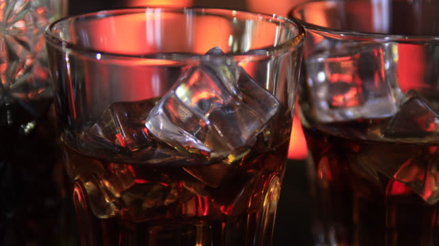two glasses and a decanter of whiskey near the fireplace. - decanter stock videos & royalty-free footage