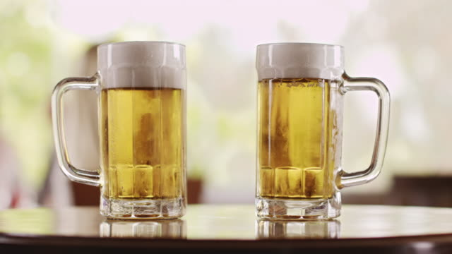 two glasses of beer - two objects stock videos & royalty-free footage