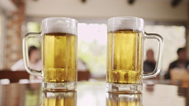 two glasses of beer - beer stein stock videos and b-roll footage