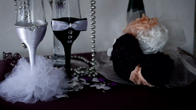 two glasses of champagne in the clothes of bride and groom - pair stock videos and b-roll footage