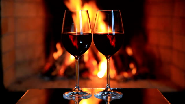 two glasses of red wine near a fireplace - pair stock videos & royalty-free footage