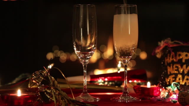 two glasses with champagne on new year's eve - champagne flute stock videos & royalty-free footage