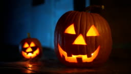 Two glowing jack-o-lanterns with eerie smoke, ready for Halloween