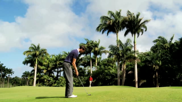 two golfers on a green - golfer stock videos & royalty-free footage