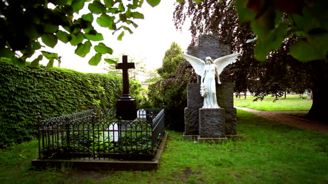 two graves - cemetery angel and cross - funeral stock videos & royalty-free footage
