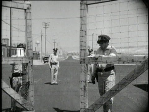 two guards close the gates to an atomic plant in oak ridge tennessee - tennessee stock videos & royalty-free footage