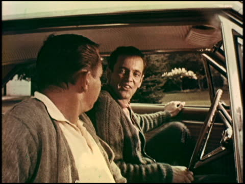 two guys drive to the bowling alley in a new rambler rogue hardtop. the driver says his rambler will outperform his friend's mustang all day long,... - 1966 bildbanksvideor och videomaterial från bakom kulisserna