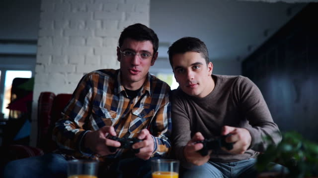 Two guys playing video games in office