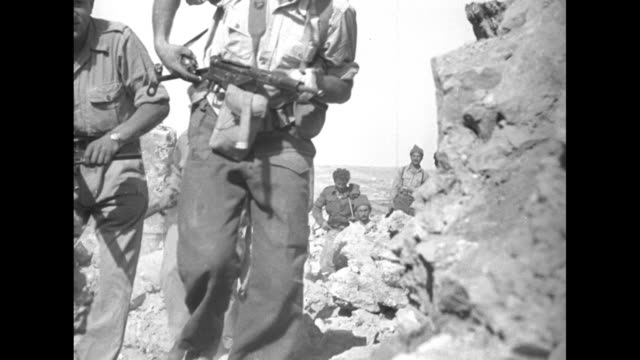 two haganah militia members man machine gun set up on promontory valley and hills in bg / men with rifles walking to camera / guard standing on top... - 1948 stock videos & royalty-free footage