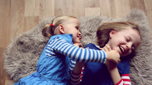 two happy children laughing on a rug - rug stock videos & royalty-free footage