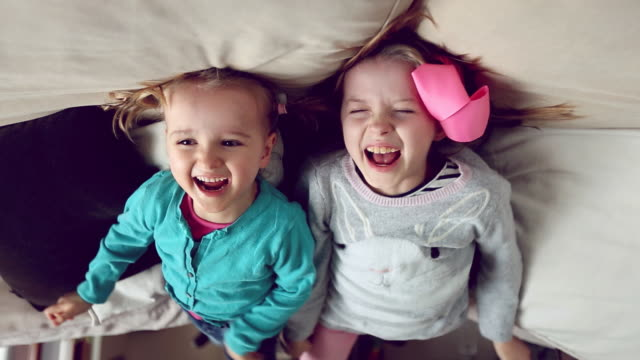 two happy children, upside down, giggling and laughing - sister stock videos & royalty-free footage