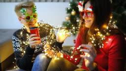 Two happy girls near christmas tree