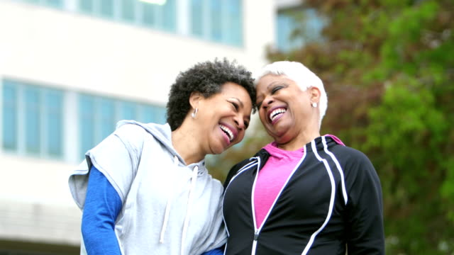 two happy mature african-american women friends laughing - sportswear stock videos & royalty-free footage