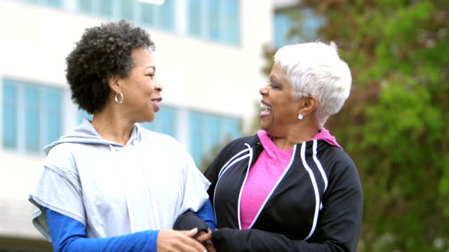 two happy mature african-american women, friends talking - white hair stock videos and b-roll footage