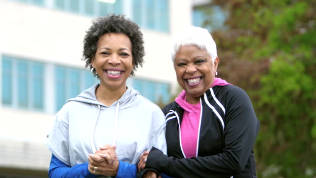 two happy mature african-american women, friends - arm in arm stock videos & royalty-free footage