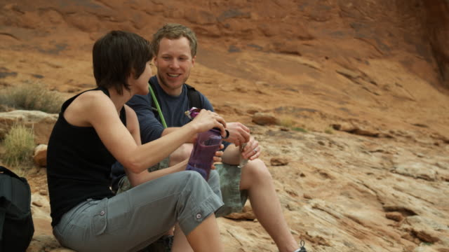 two hikers stopping for a break - protein bar stock videos & royalty-free footage