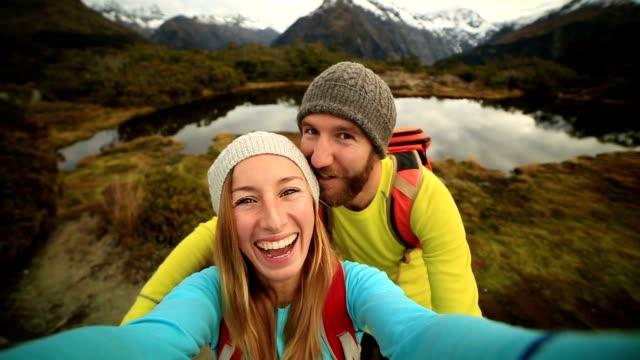 two hikers take selfie portrait, autumn - selfie stock videos & royalty-free footage