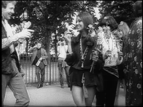 b/w 1967 two hippies smiling holding flowers at bein / hyde park london / newsreel - hyde park london stock videos & royalty-free footage
