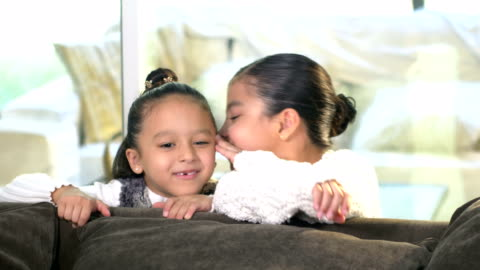 two hispanic sisters whispering secrets to each other - 6 7 years stock videos & royalty-free footage