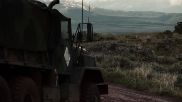 stockvideo's en b-roll-footage met two humvees on a dirt road, training explosives create smoke and explode.  - humvee