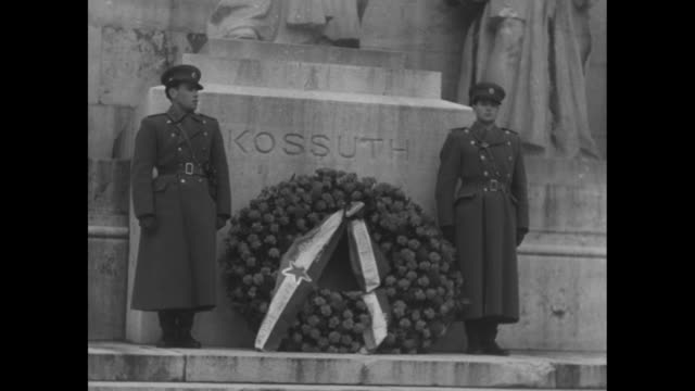 Two Hungarian soldiers standing at base of tomb of 19th Century Hungarian political leader Lajos Kossuth in Kerepesi Cemetery in Budapest / Hungarian...