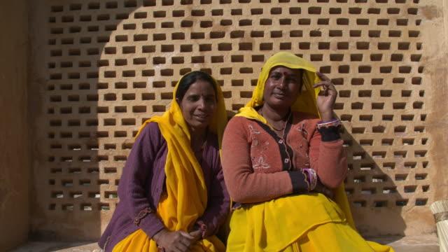 vídeos y material grabado en eventos de stock de two indian women in yellow vails in amber palace - palace