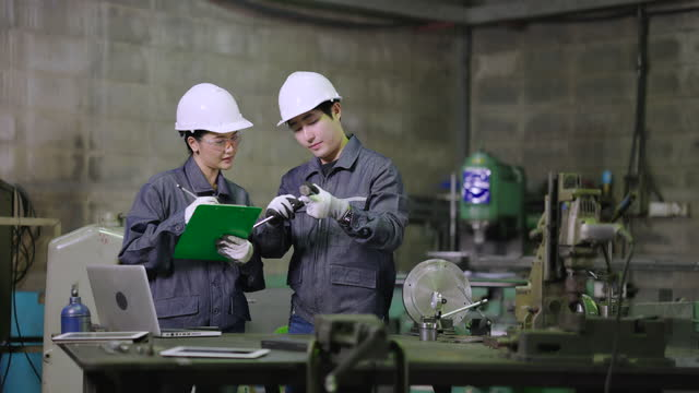 two industrial engineers sampling check the product part dimension in the factory workshop. - vernier calliper stock videos & royalty-free footage