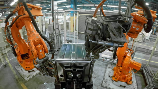 ld two industrial robots welding a product - automatic stock videos & royalty-free footage
