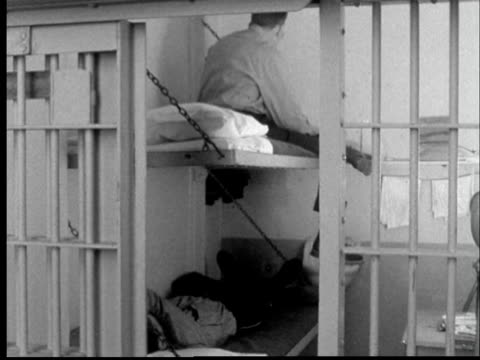 1956 ms two inmates on bunks in prison cell as cell gate closes/ lansing, michigan - security screen stock videos & royalty-free footage