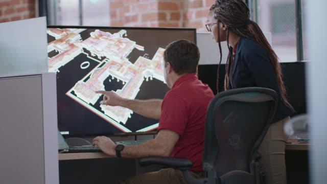 two intelligent business partners analyze a 3d blueprint model on a large digital display monitor - computer graphic stock-videos und b-roll-filmmaterial
