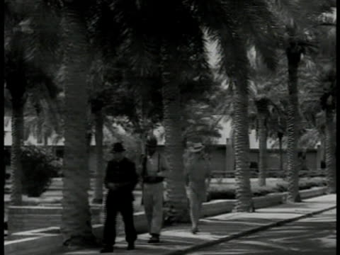 two iranian soldiers patrolling waterfront soldiers walking on sidewalk by park male in shorts walking around two caucasian women packing suitcases - 1951 stock videos & royalty-free footage