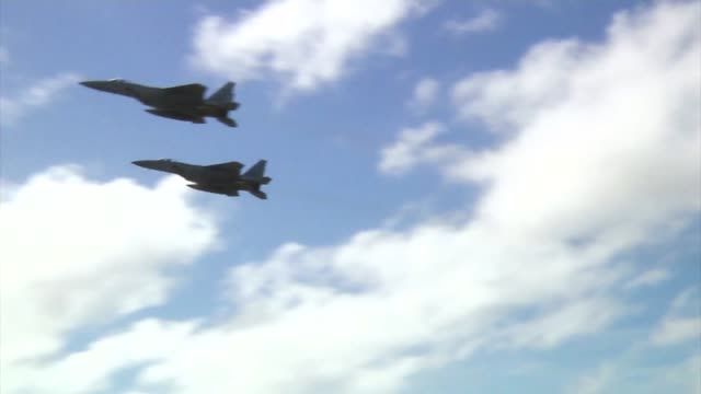 two japan air self defence f-15 eagles take off together from andersen air force base, guam during exercise cope north 19. - guam stock videos & royalty-free footage