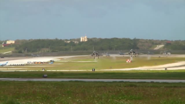 two japan air self defence f-15 eagles take off together from andersen air force base, guam during exercise cope north 19. - guam video stock e b–roll