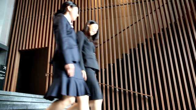 two japanese business women walking down stairs - lypsekyo16 stock videos and b-roll footage