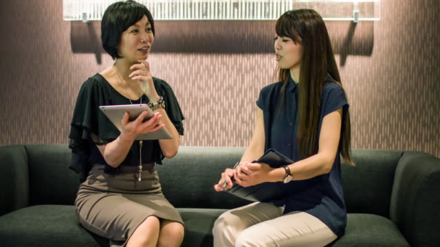 Two Japanese businesswomen on a meeting